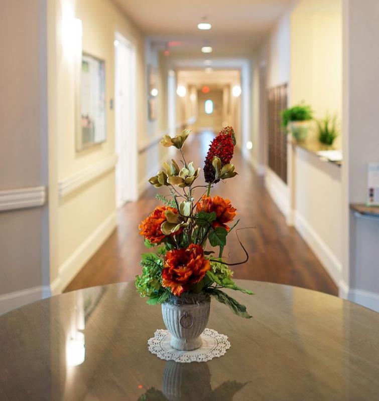 Vantage Pointe Village | Flowers in hallway