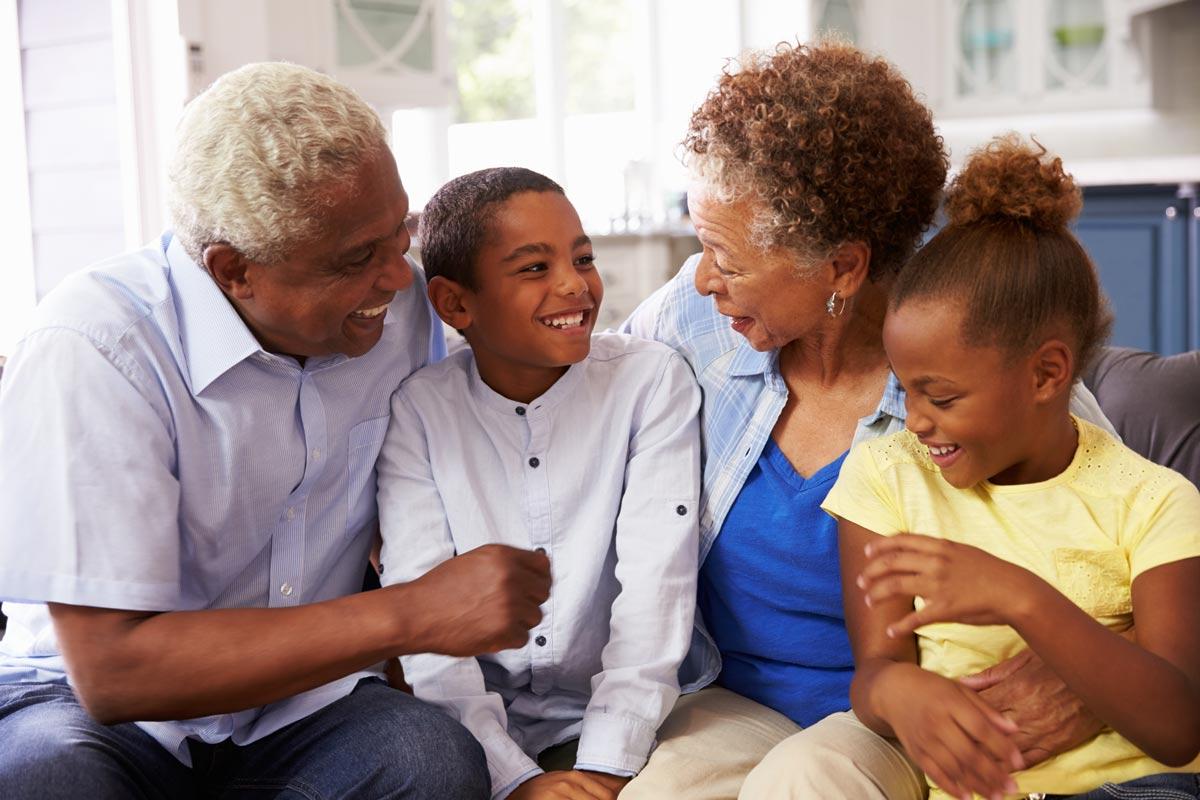 Vantage Pointe Village | Senior couple with grandchildren