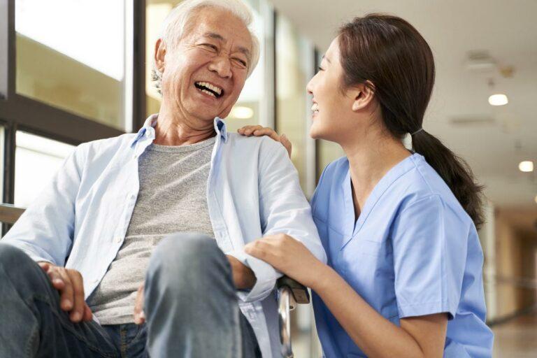 Vantage Pointe Village | Senior man laughing with caregiver
