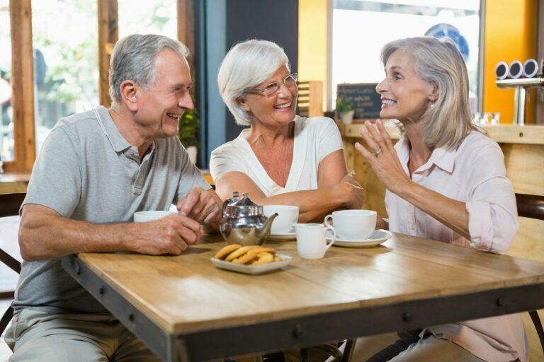 Vantage Pointe Village | Seniors talking at breakfast table