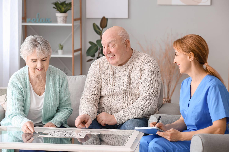 Vantage Pointe Village | Seniors working on puzzle with caregiver