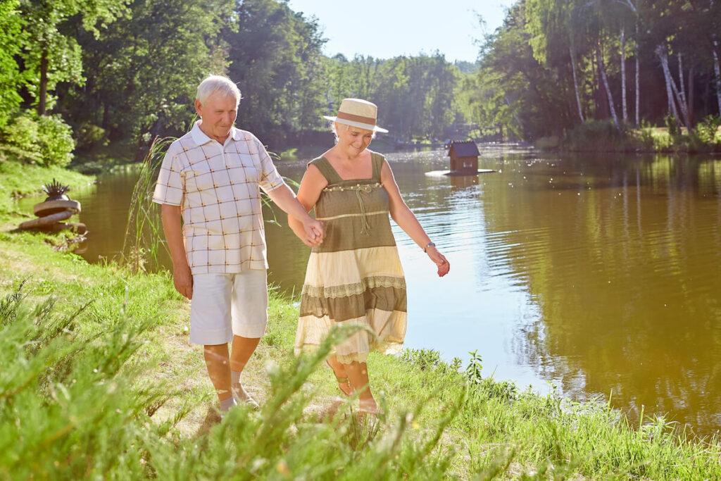 Vantage Pointe Village   Senior couple walking by the river