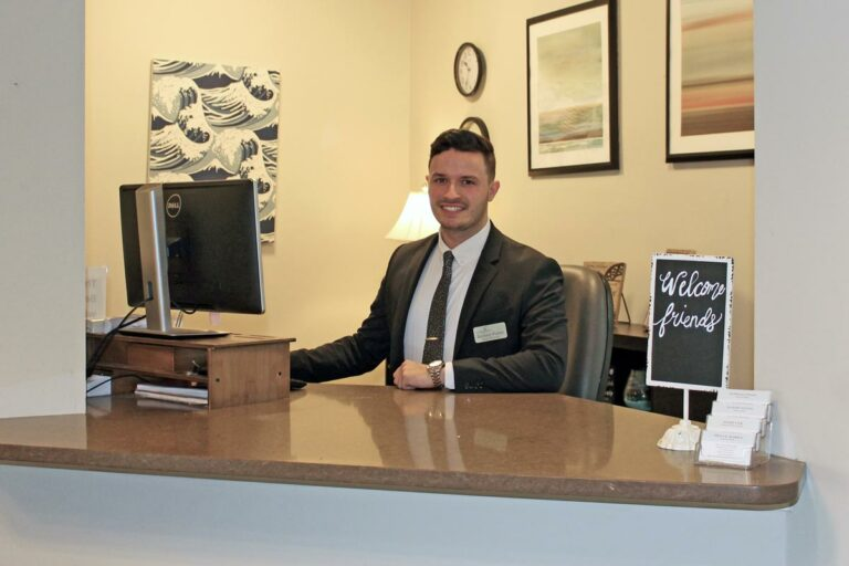 Vantage Pointe Village | Zachary, the receptionist at the front desk